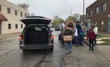 volunteers put food in a trunk