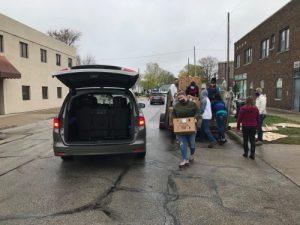 volunteers put food in a trunk